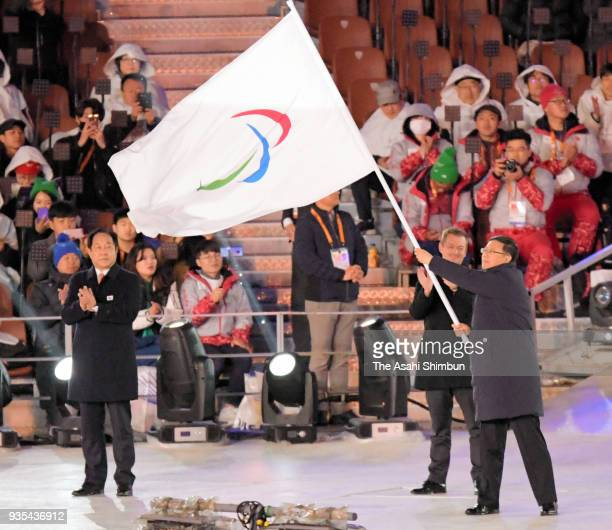 Mayor of Beijing Chen Jining waves the Paralympic flag during the closing ceremony of the PyeongChang 2018 Paralympic Games at the PyeongChang...