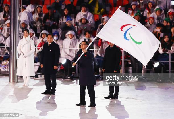 Mayor of Beijing Chen Jining waves the Paralympic flag next to President of the International Paralympic Committe Andrew Parsons during the closing...