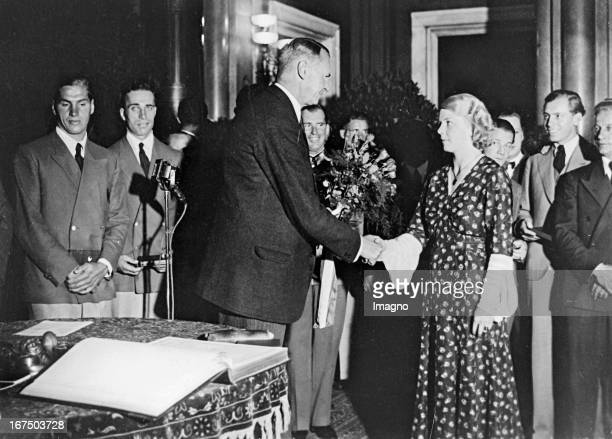 Mayor of Berlin Heinrich Sahm congratulates Ellen Braumüller at a reception for the Olympian athletes to her silver medal in the javelin at the...