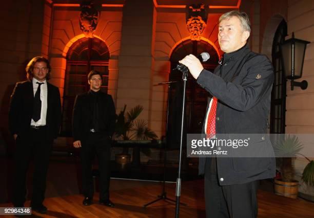 Mayor of Berlin Klaus Wowereit receives the 'Belstaff for Peace' jacket from Michele Malenotti and Manuele Malenotti vice presidents of Belstaff...