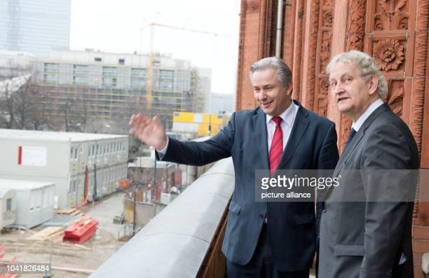 Mayor of Berlin Klaus Wowereit shows Mayor of Amsterdam Eberhard van der Laan his view from his office in city hall in Berlin Germany 11 December...