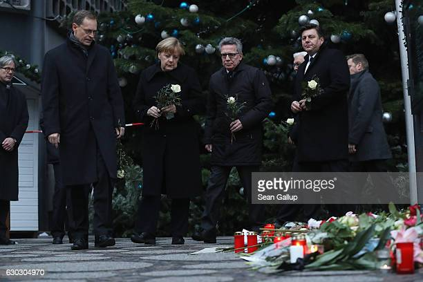 Mayor of Berlin Michael Mueller German Chancellor Angela Merkel German Interior Minister Thomas de Maiziere and Berlin city Interior Minister Andreas...
