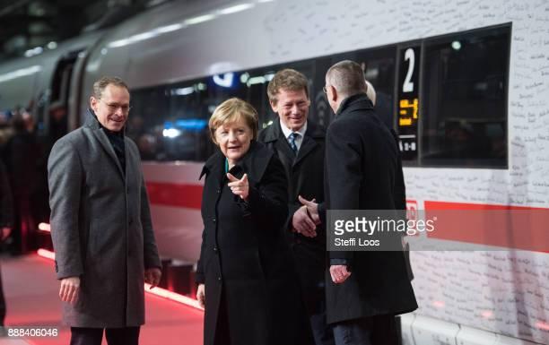Mayor of Berlin Michael Mueller welcomes German Chancellor Angela Merkel and Chairman of German railway operator Deutsche Bahn Richard Lutz in front...