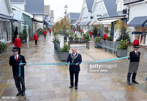 Mayor of Bicester Councillor Les Sibley cuts the ribbon for the new Bicester Village on October 19 2017 in Bicester England