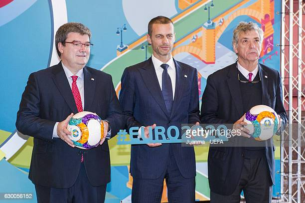 Mayor of Bilbao Jose Maria Aburto UEFA president Aleksander Ceferin and president of RFEF Angel Maria Villar pose in front of the Bilbao logo for the...