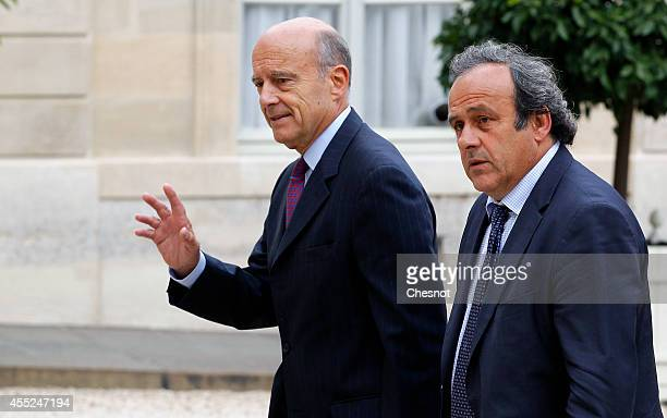 Mayor of Bordeaux Alain Juppe and UEFA President Michel Platini arrive at the Elysee Palace for a lunch with French President Francois Hollande for...