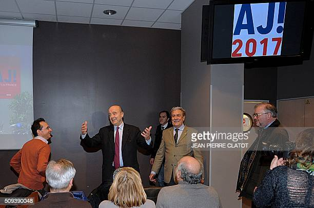 Mayor of Bordeaux and candidate for Les Republicains rightwing party primary Alain Juppe gestures as he arrives to the 'Stade des Alpes' stadium of...
