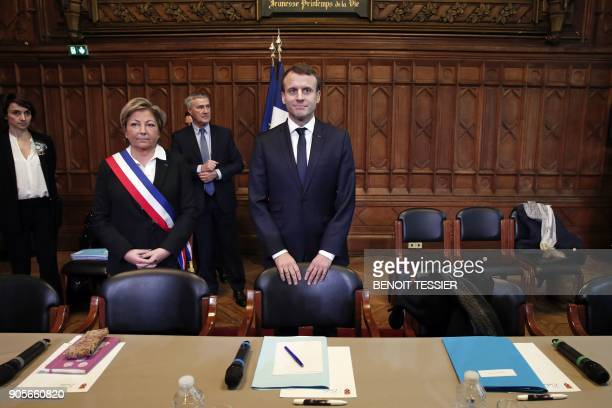 Mayor of Calais Natacha Bouchart and French President Emmanuel Macron attend a meeting at the Calais' townhall northern France on January 16 2018...