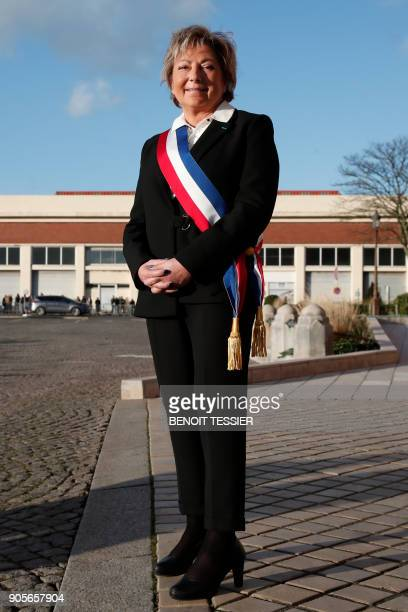 Mayor of Calais Natacha Bouchart smiles as she waits for the arrival of French President in front of the Calais' townhall northern France on January...