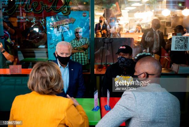 Mayor of Charlotte Vi Lyles and Oklahoma City Thunder NBA player Chris Paul sit with Democratic Presidential Candidate Joe Biden and Tia Bazzelle,...