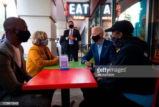 Mayor of Charlotte Vi Lyles and Oklahoma City Thunder NBA player Chris Paul sit with Democratic Presidential Candidate Joe Biden and Tia Bazzelle...