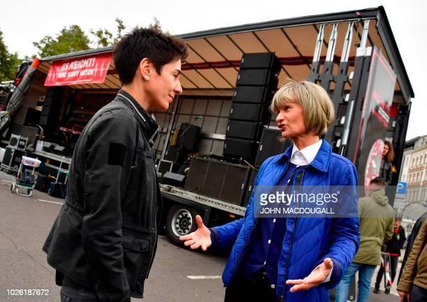 Mayor of Chemnitz Barbara Ludwig speaks to reporter Dunja Hayali before addressing a counterdemonstration in Chemnitz eastern Germany on September 1...