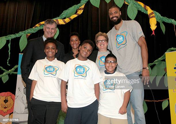 Mayor of Dallas Mike Rawlings Kimberly Chandler president and CEO of the US Fund for UNICEF Caryl Stern UNICEF Ambassador Tyson Chandler and...