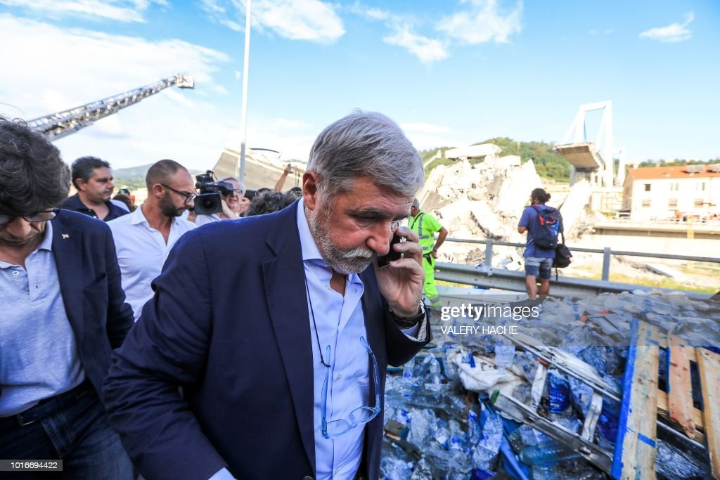 Mayor of Genoa Marco Bucci speaks on a mobile as he walks at the ...