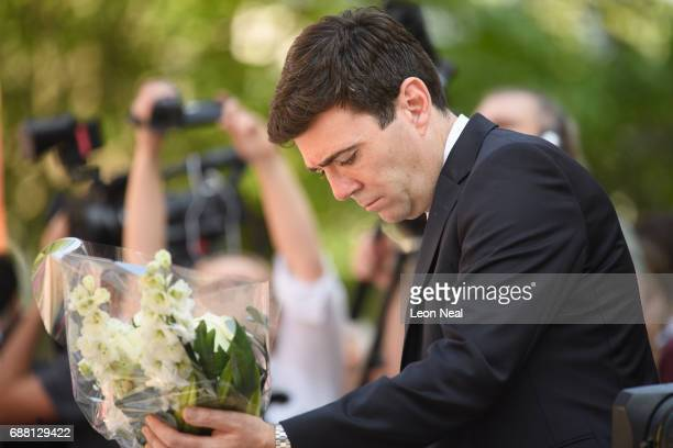 Mayor of Greater Manchester Andy Burnham lays a floral tribute following a national minute's silence in remembrance of all those who lost their lives...