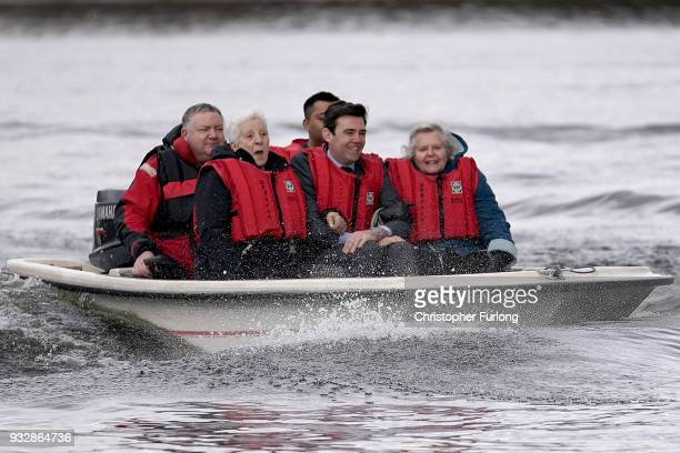 Mayor of Greater Manchester Andy Burnham takes part in a powerboat ride with pensioners on March 16 2018 in Manchester England The World Health...
