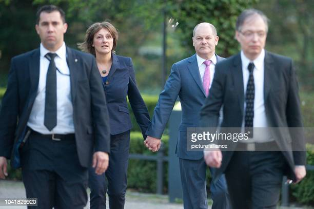Mayor of Hamburg Olaf Scholz and his wife Britta Ernst arrive for a reception celebrating former German chancellor Gerhard Schroeder's 70th birthday...
