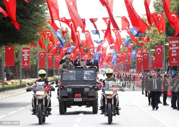 Mayor of Istanbul Kadir Topbas, Istanbul governor Vasip Sahin and 1st Army Commander Musa Avsever greet during the celebrations at Vatan street to...
