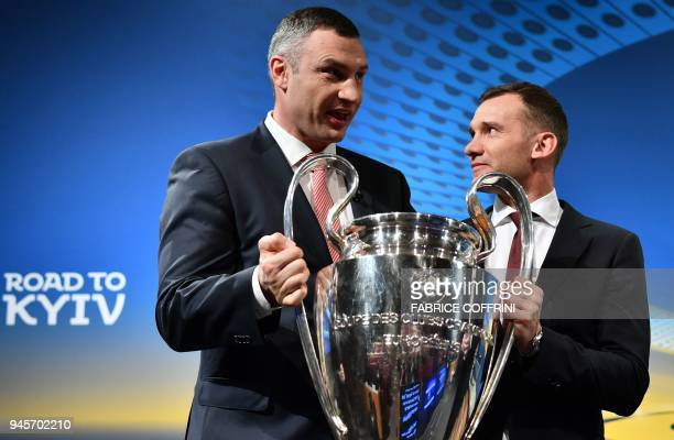 TOPSHOT Mayor of Kiev and former boxing champion Vitali Klitschko poses with former Ukrainian soccer player and ambassador for the UEFA Champion...