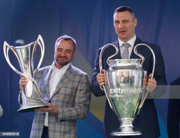 Mayor of Kiev Vitali Klitschko and President Ukrainian soccer federation Andriy Pavelko hold the Champions league trophies at the hand over ceremony...