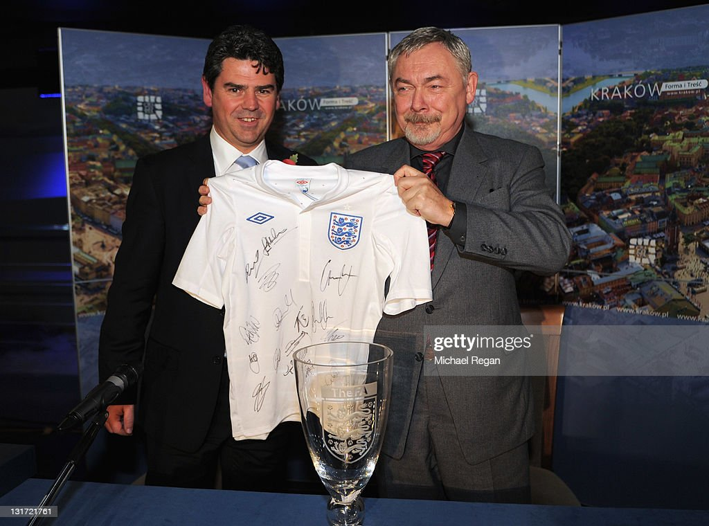 Mayor of Krakow Jacek Majchrowski shows a signed England shirt presented to him by Managing Director of Club England Adrian Bevington during a press conference to announce Krakow as the England football teams base for the 2012 European Championships on November 7, 2011 in Krakow, Poland.