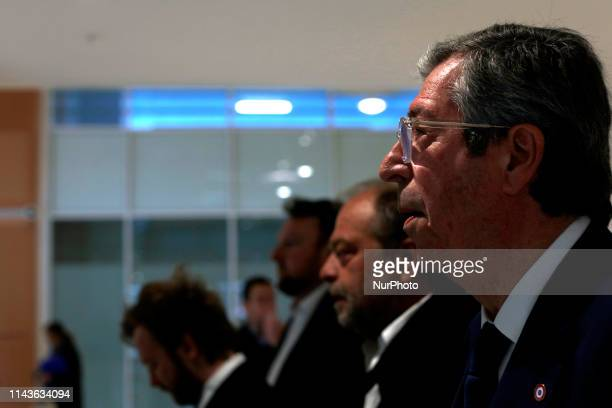 Mayor of LevalloisPerret Patrick Balkany arrives with his layer Eric DupondMoretti at Paris courthouse on May 13 2019 as he is being prosecuted with...