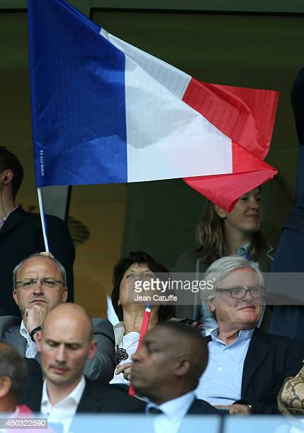 Mayor of Lille Martine Aubry waves a flag during the international friendly match between France and Jamaica at Grand Stade Pierre Mauroy on June 8...