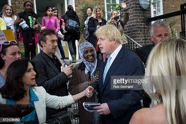 Mayor of London Boris Johnson and his wife Marina Wheeler speak to members of the public outside a polling station in the London Borough of Islington...