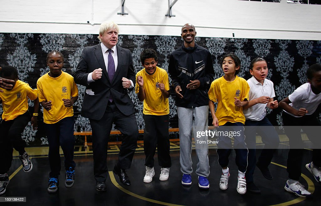 Mayor of London Boris Johnson and Mo Farah of Great Britain do some exercise with school kids whilst they were at Lilian Baylis Old School to announce the findings of a report published today, written by the Young Foundation and funded by Nike, which finds that physical inactivity costs the UK economy GBP 8.2bn per year. The Move It report warns that England faces an epidemic of physical inactivity unless the Government makes significant changes to the nation's sporting infrastructure. For more information www.designedtomove.org on October 1, 2012 in London, England.