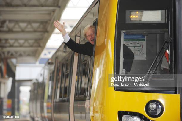 Mayor of London Boris Johnson arrives at Willesden Junction on a walk through the 'worm design' carriage in the first of 54 new trains for Transport...