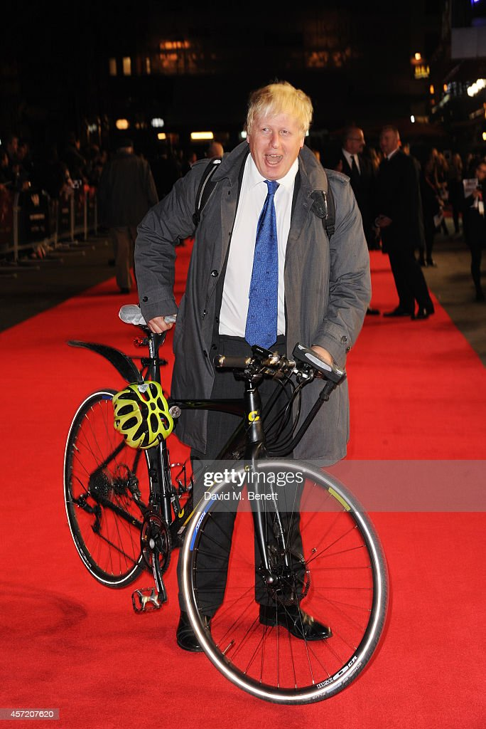 Mayor Of London Boris Johnson arrives by bicycle at a screening of 'Testament of Youth' during the 58th BFI London Film Festival at Odeon Leicester Square on October 14, 2014 in London, England.