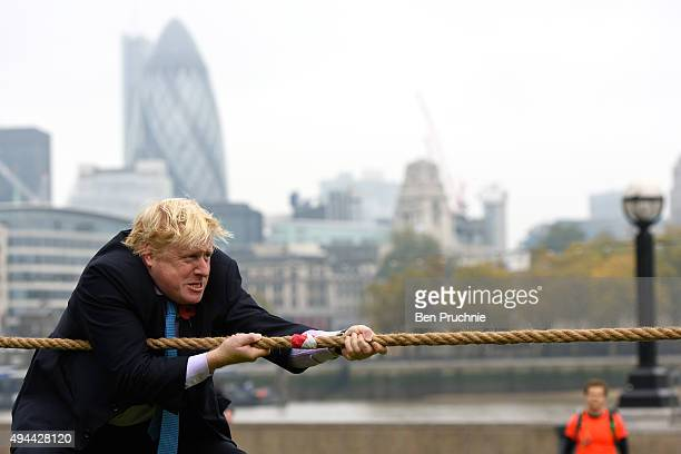 Mayor of London Boris Johnson competes in a tug of war during the launch of London Poppy Day on October 27, 2015 in London, England. Poppies have...