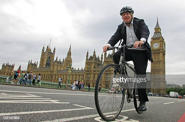 Mayor of London Boris Johnson, cycles his bike over Westminster Bridge in central London on July 30, 2010. London launched a major cycle hire scheme...