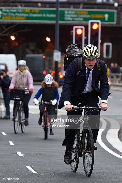 Mayor of London Boris Johnson cycles over Vauxhall Bridge to launch London's first cycle superhighway on November 19, 2015 in London, England....
