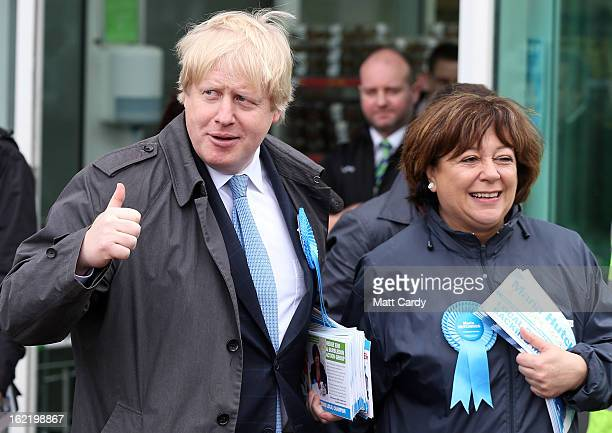 Mayor Of London Boris Johnson gives a thumbs up to members of the media as he leaves an ASDA superstore with Conservative candidate Maria Hutchings...