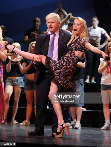Mayor of London Boris Johnson holds Dance Champion Camilla Dallerup at the launch of the TMobile Big Dance 2010 at The London Palladium on July 1...