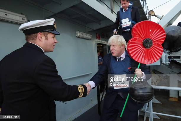 Mayor of London Boris Johnson is winched on board HMS Severn to take part in a photocall on October 30, 2012 in London, England. Mr Johnson was...