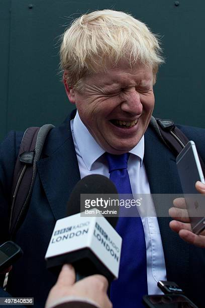 Mayor of London Boris Johnson laughs as he is interviewed by journalists at the launch of London's first cycle superhighway on November 19 2015 in...