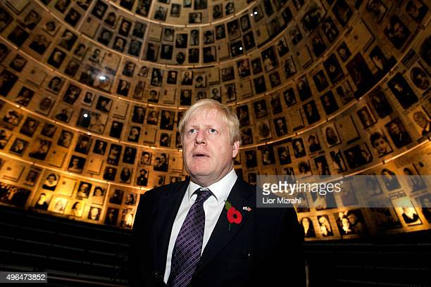 Mayor of London Boris Johnson looks at pictures of Jewish Holocaust victims at the Hall of Names during his visit to the Yad Vashem Holocaust...