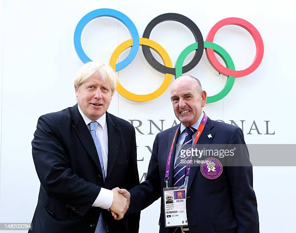 Mayor of London Boris Johnson meets Mayor of the Olympic Village Sir Charles Allen as he visits the Olympic Park and Olympic Village on July 12, 2012...