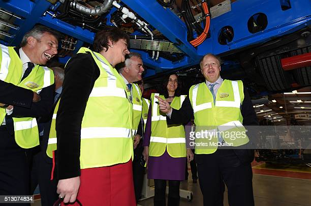 Mayor of London Boris Johnson pictured at Wrightbus' Antrim factory chats with Northern Ireland secretary of state Theresa Villiers Ian Paisley Jr...