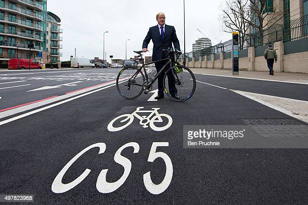 Mayor of London Boris Johnson poses for photographs at the launch of London's first cycle superhighway on November 19 2015 in London England...