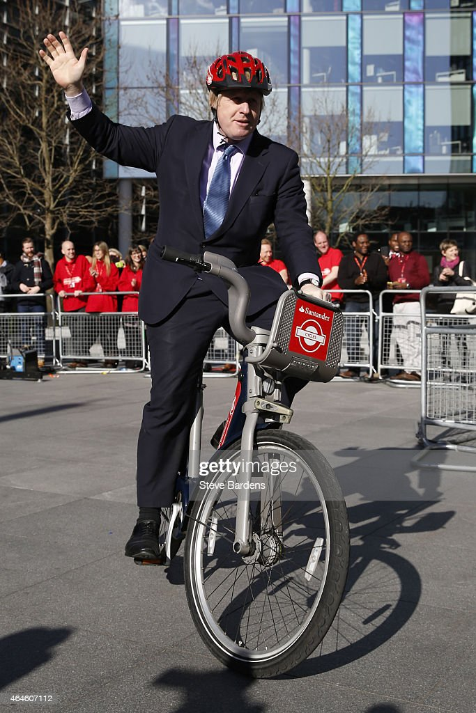 Mayor of London, Boris Johnson rides a bicycle during the announcement of Santander as the new sponsor of Santander Cycles on 27, 2015 in London, England.