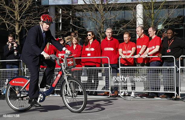 Mayor of London Boris Johnson rides a bicycle during the announcement of Santander as the new sponsor of Santander Cycles on 27 2015 in London England