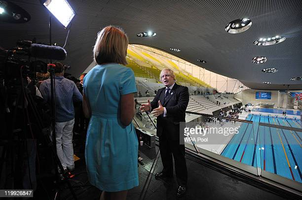 Mayor of London Boris Johnson speaks during a television interview during the opening of the Aquatics Centre venue for the London 2012 Olympic Games...