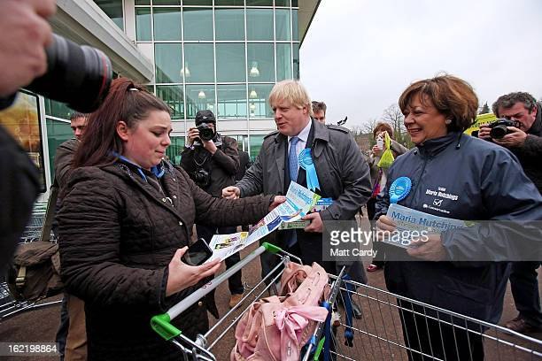 Mayor Of London Boris Johnson speaks to a shopper as he arrives at an ASDA superstore with Conservative candidate Maria Hutchings during a visit to...