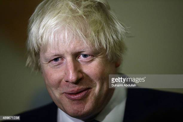 Mayor of London Boris Johnson speaks to the media during the FinTech event at the ArtScience Museum on November 28 2014 in Singapore Mayor Boris...