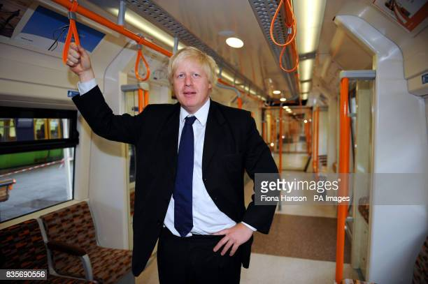 Mayor of London Boris Johnson stands in the 'worm design' carriage in the first of 54 new trains for Transport for London's Overground network which...