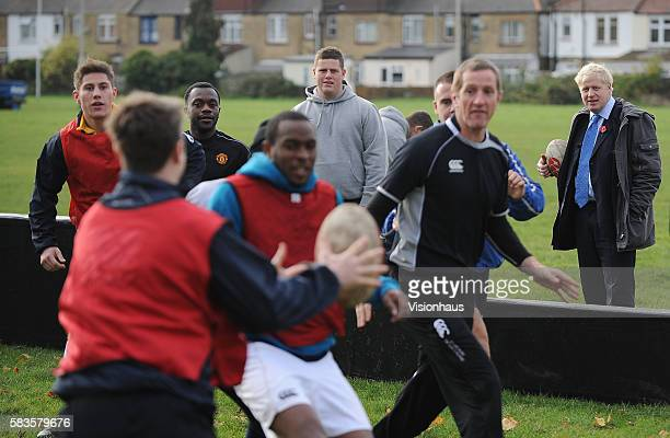 """Mayor of London - Boris Johnson watches a training session during filming of the Sky Sports 1 programme """"School of Hard Knocks. Presented by former..."""
