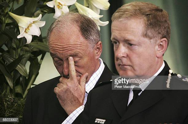 Mayor of London Ken Livingstone rubs his eye as he and the Commissioner of the Metropolitan Police Sir Ian Blair wait to sign a book of condolences...